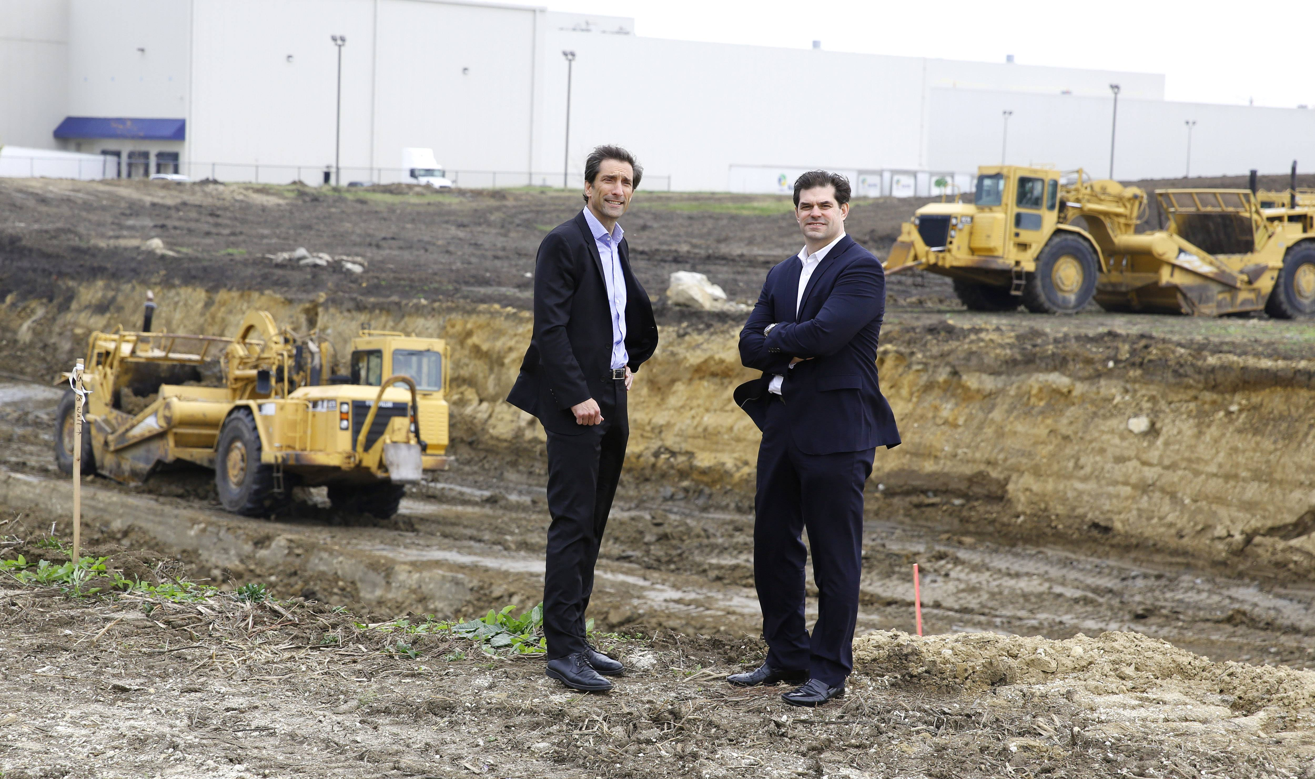 JLL's Keith Stauber, managing director of the Midwest Industrial Services Group, left, and Steve Ostrowski, vice president of Industrial Real Estate Services, right, stand in front of what will become a new spec building to be completed in June 2017. The 271,000-square-foot building is a joint venture between Stockbridge and Ventureone.