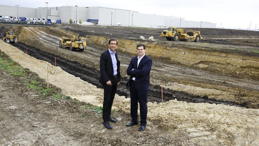 JLL's Keith Stauber, managing director of the Midwest Industrial Services Group, left, and Steve Ostrowski, vice president of Industrial Real Estate Services, stand in front of what will become a new spec building to be completed in June 2017. The 271,000-square-foot building is a joint venture between Stockbridge and Ventureone.