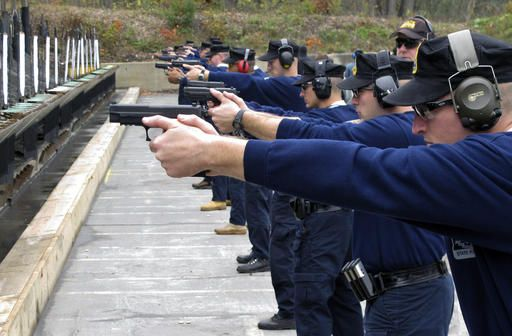"FILE - In this Oct. 24, 2012, file photo, Connecticut State Police recruits practice with their new .45-caliber Sig Sauer pistols during a ""dry fire"" exercise at the state police firing range in Simsbury, Conn. Some police departments are relaxing age-old standards for accepting recruits. The changes are designed to deal with decreased interest in a job that offers low pay, rigorous physical demands and the possibility of death, all while under public scrutiny. There's also the need to lure more minorities. The Connecticut State Police is among the agencies wrestling with diversity."