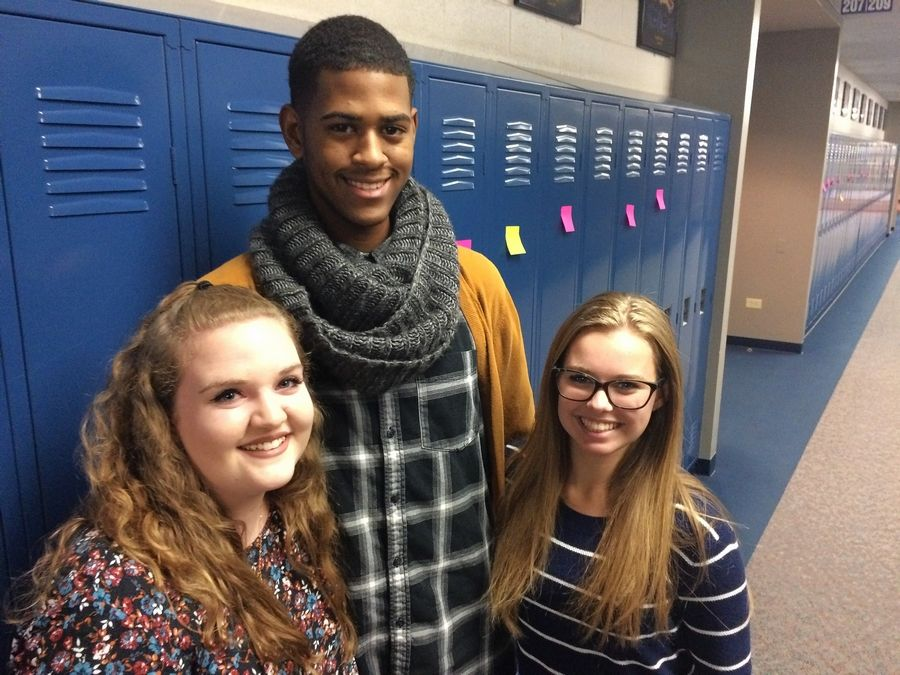 From left to right, Kathryn Haynes, Jaylen Davis and Amanda Middleton -- all students at Warren Township High School's junior-senior Almond Road campus -- were among those who wrote positive messages on sticky notes and posted them on all 2,500 lockers Monday. They responded to racist graffiti that was found on bathroom stalls at Warren's two campuses last week.