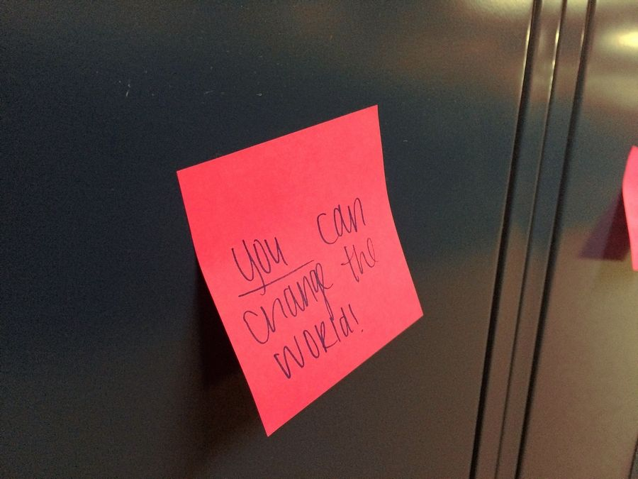 About 10 students at Warren Township High School's Almond Road junior-senior campus were part of an effort to write positive messages on sticky notes and post them on all 2,500 lockers Monday. They responded to racist graffiti that was found on bathroom stalls at Warren's two campuses last week.