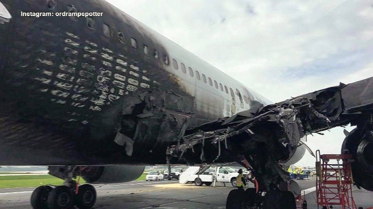 The right wing of an American Airlines 767 was charred after an engine part shattered and ignited the plane Oct. 28.
