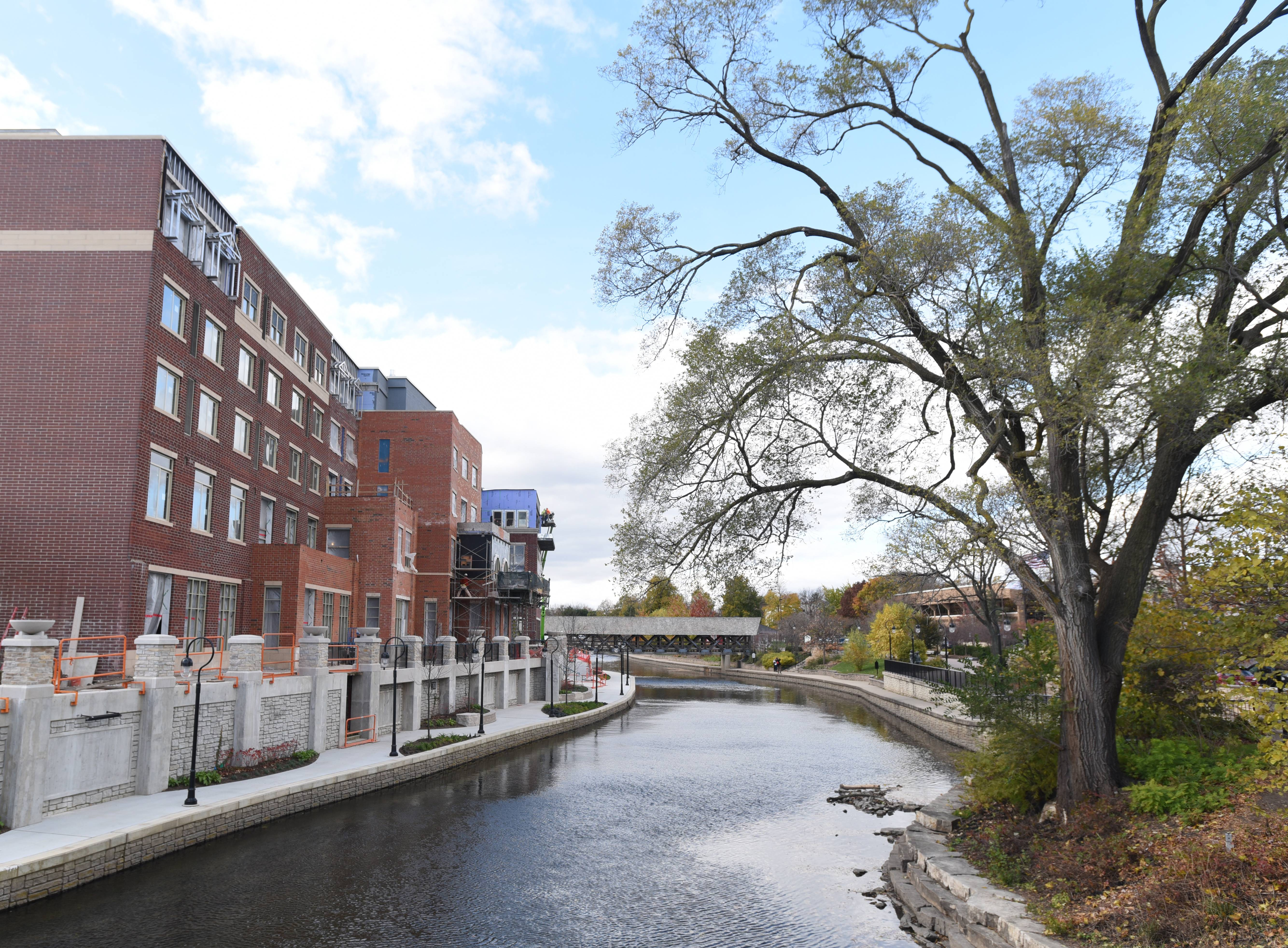Rising from the south bank of the DuPage River in downtown Naperville is a $93 million hospitality destination for which the city has waited nearly a decade -- the Water Street District anchored by the Hotel Indigo Naperville Riverwalk.