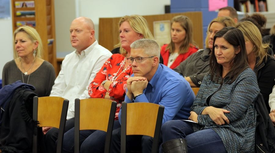 Steve Lundy/slundy@dailyherald.comConcerned parents listen to comments by the District 95 school board during their meeting Wednesday at Lake Zurich High School.