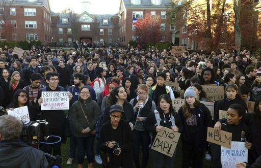 Students protest on the Brown University campus, Wednesday, Nov. 16, 2016, in Providence, R.I., to demand that students and employees be protected against immigration proceedings following the election of Donald Trump as president. Hundreds of students walked out of their classrooms and activities at 3 p.m.