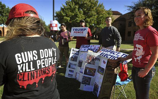 A small group of Trump supporters counter an anti-Trump rally on the Midwestern State University campus Wednesday, Nov. 16, 2016, in Wichita Falls, Texas. (Torin Halsey /Times Record News via AP)