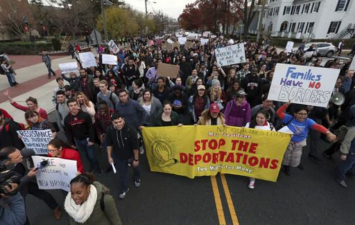 Hundreds of Rutgers University students block College Ave., in New Brunswick, N.J., as they march to protest some of President elect Donald Trump's policies and to ask school officials to denounce some of his plans at Rutgers University Wednesday, Nov. 16, 2016, in New Brunswick, N.J. College students at campuses around the United States say they are planning rallies and walkouts to call on school administrators to protect students and employees against immigration proceedings under Donald Trump's presidency.