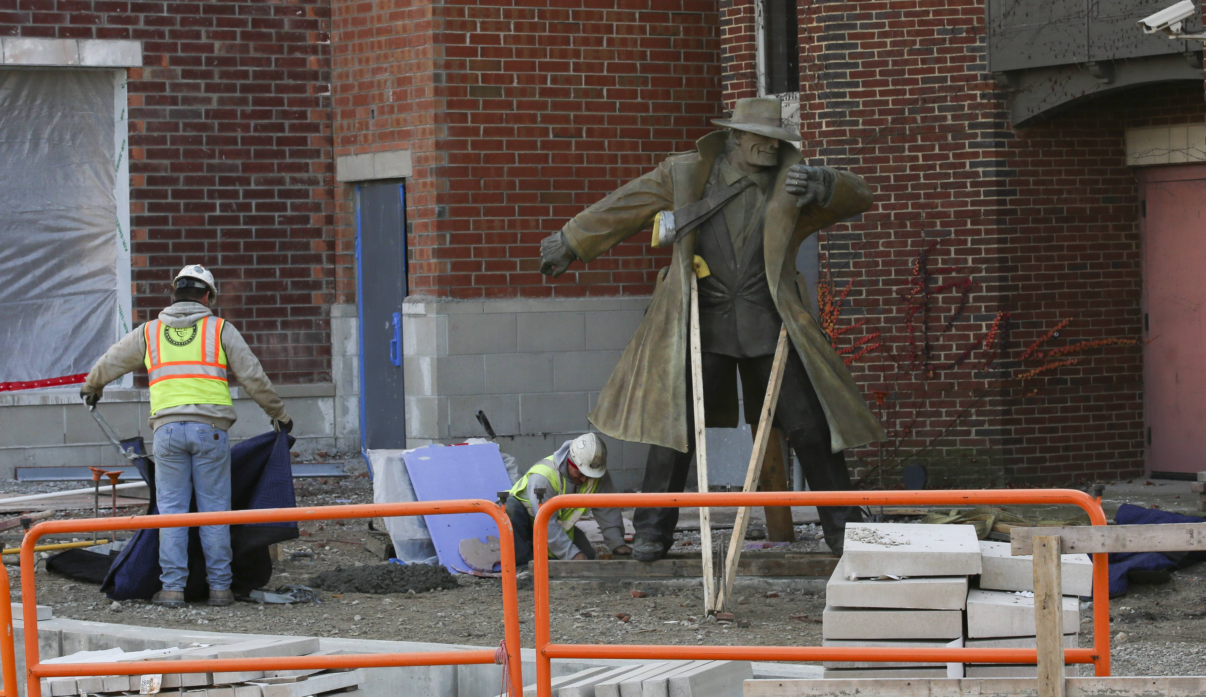 Naperville's Dick Tracy sculpture was placed in a permanent location Thursday near the Water Street District.