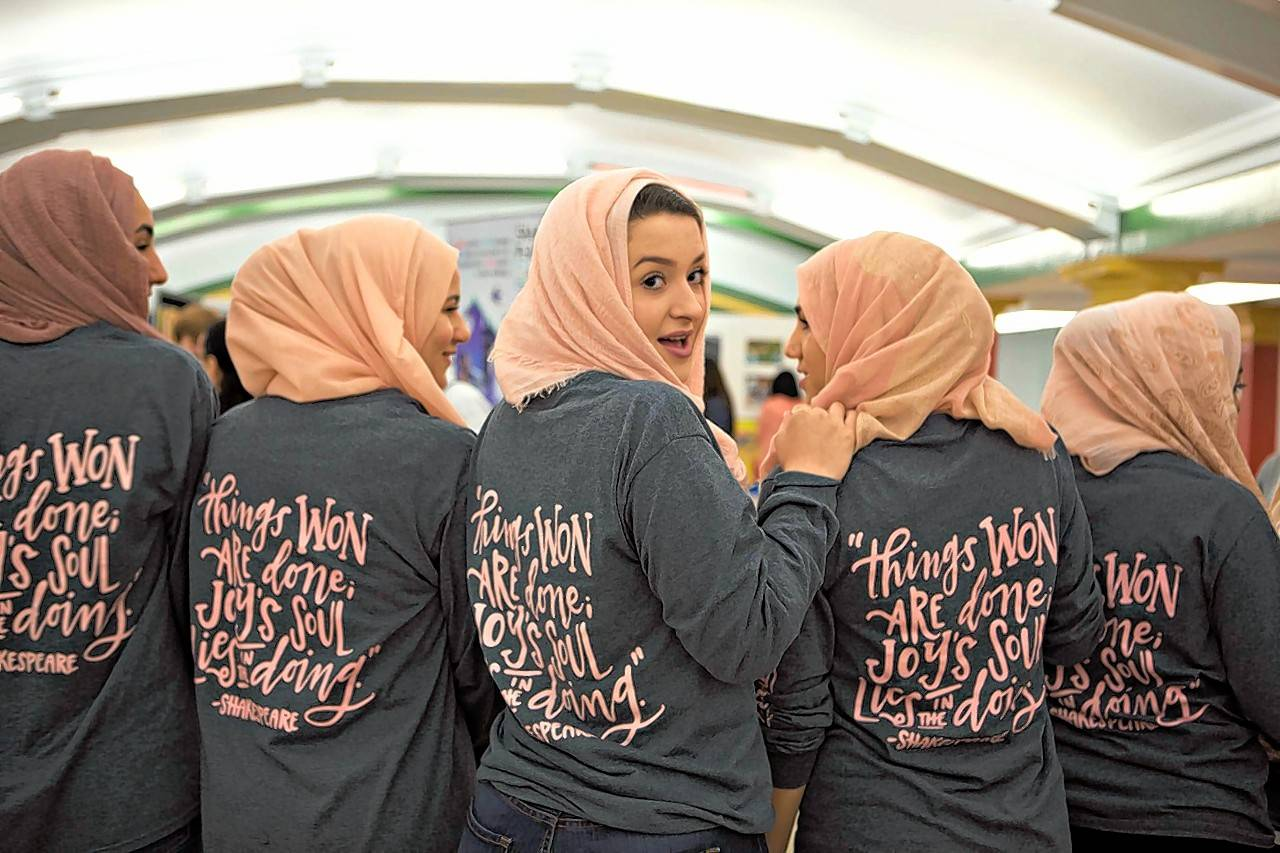"Sporting matching hijabs and T-shirts, students from the Islamic Foundation School in Villa Park performed an ensemble piece titled ""She Is"" at the Chicago Shakespeare Theater as part of a high school Battle of the Bard competition and celebration."