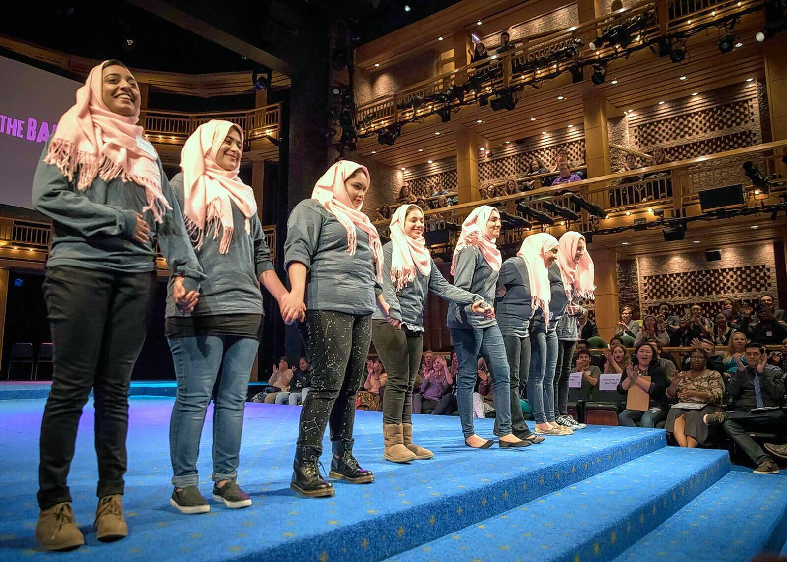 "Taking a curtain call after their performance of an original ""mash-up"" of Shakespearean quotes about women, students from the Islamic Foundation School of Villa Park say their piece, titled ""She Is,"" helped them break stereotypes."