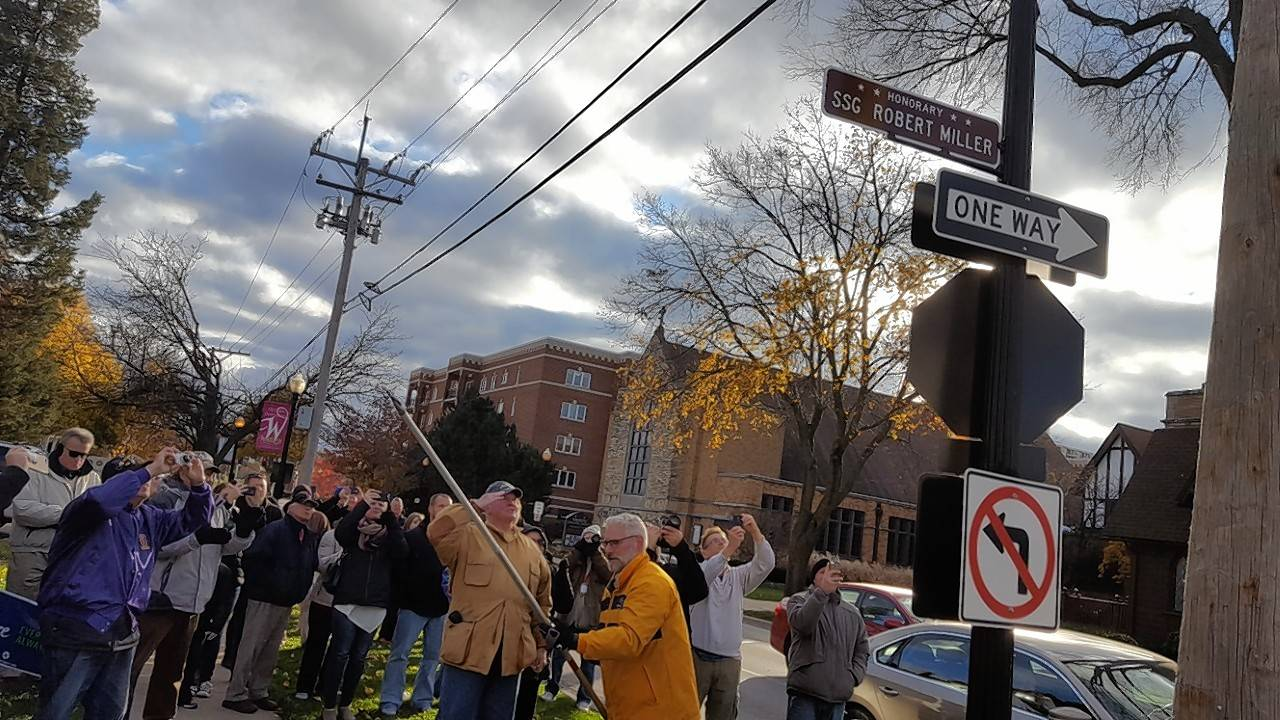 Army Staff Sgt. Robert J. Miller, who was posthumously awarded the Medal of Honor, was recognized Saturday afternoon with an honorary street sign at West and Wesley streets in Wheaton.