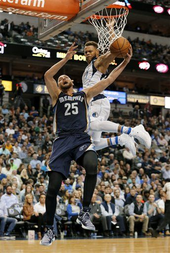 Memphis Grizzlies forward Chandler Parsons (25) is fouled leaping to the basket for a shot by Dallas Mavericks' Justin Anderson, top, in the first half of an NBA basketball game, Friday Nov. 18, 2016, in Dallas.