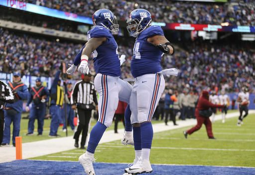 f9a0fb65897 New York Giants tight end Will Tye, left, celebrates with offensive tackle  Ereck Flowers