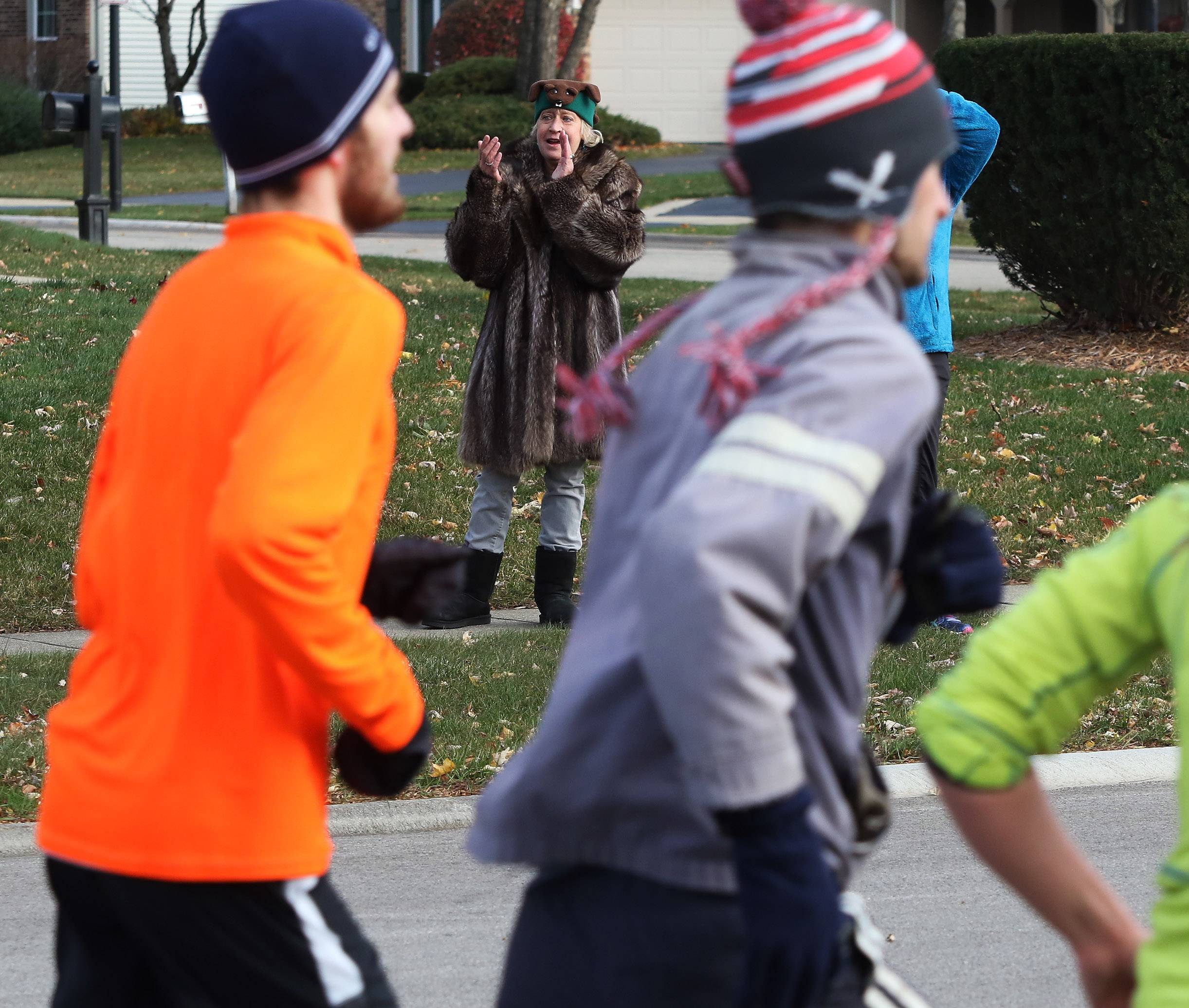 Beverly Wargo of Park Ridge cheers on the runners during the Hoofin' 4 Hardy 5k race Sunday in Palatine. The money was a memorial for Joshua Jared Hardy who died in 2009 to support free testing at local high schools for hypertrophic cardiomyopathy.