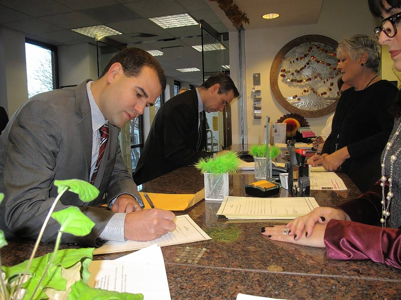 Mike Isaac, left, and Naperville City Council member Kevin Coyne file nominating petitions Monday morning to seek one of four open seats on the council in the spring 2017 election.