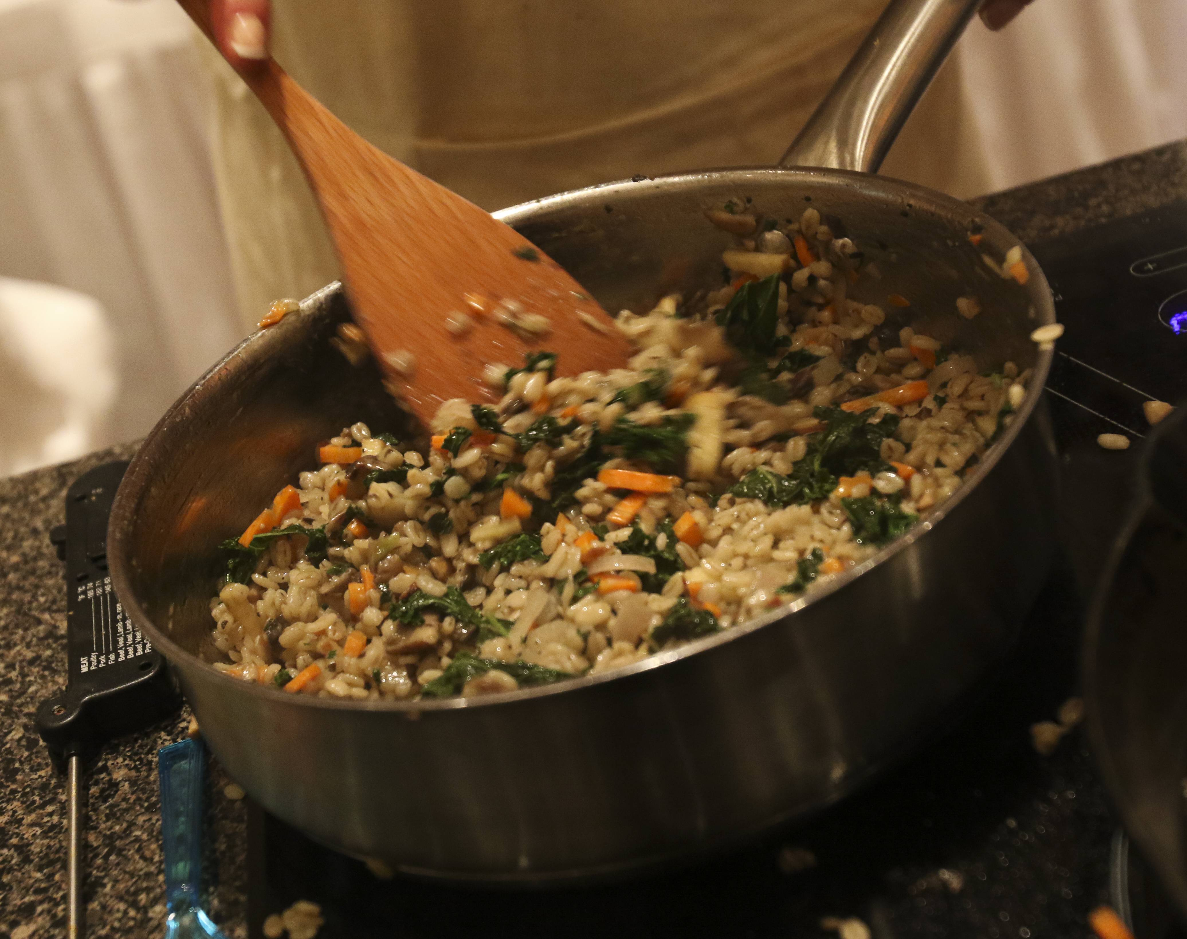Teresa Fiocchi of Mundelein cooks up her barely kale pilaf.