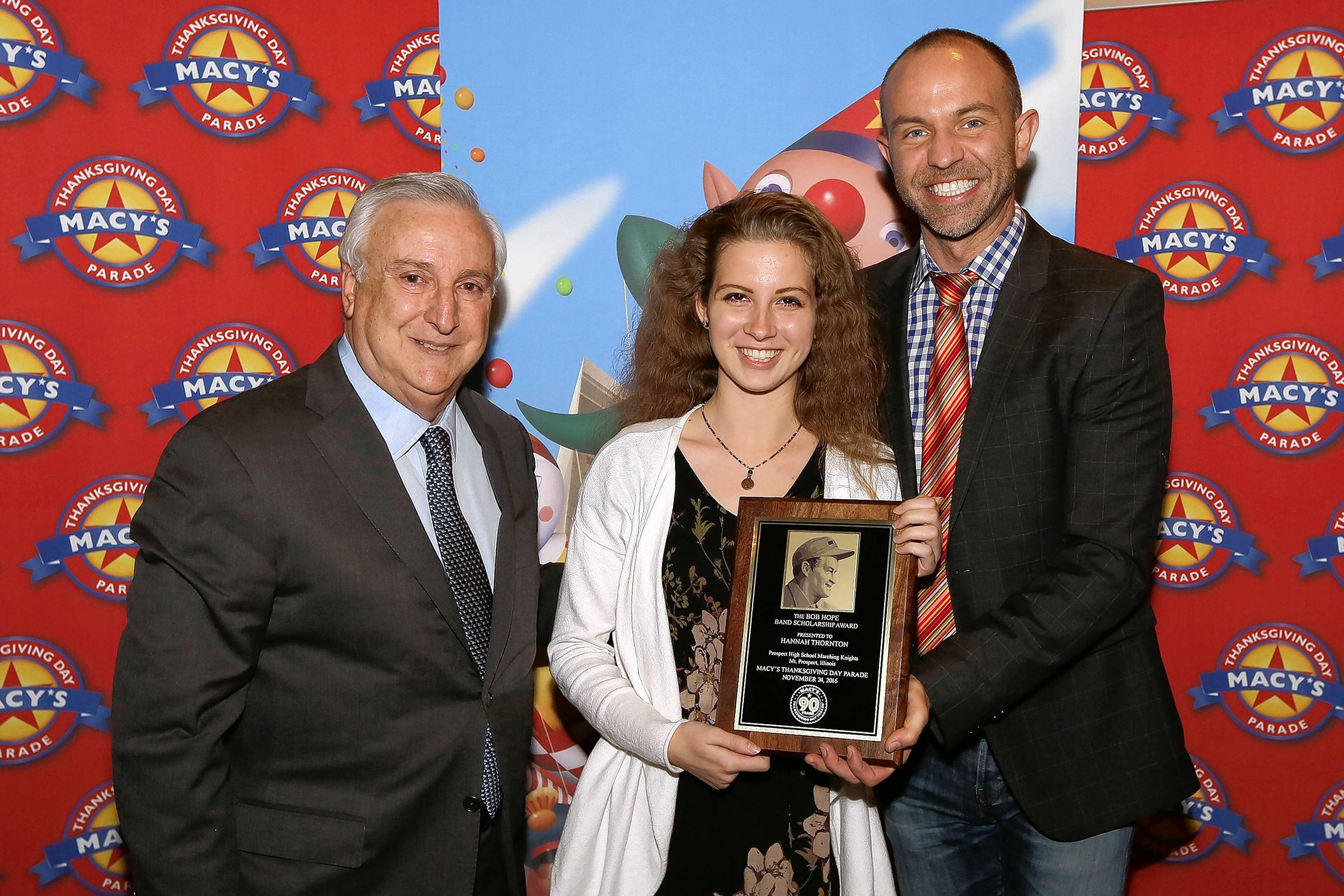 Tony Montalto, left, executive director of the Bob & Dolores Hope Foundation, stands with scholarship award winner Hannah Thornton of Prospect High School and Wesley Whatley, creative director of the Macy's Parade and Entertainment Group.