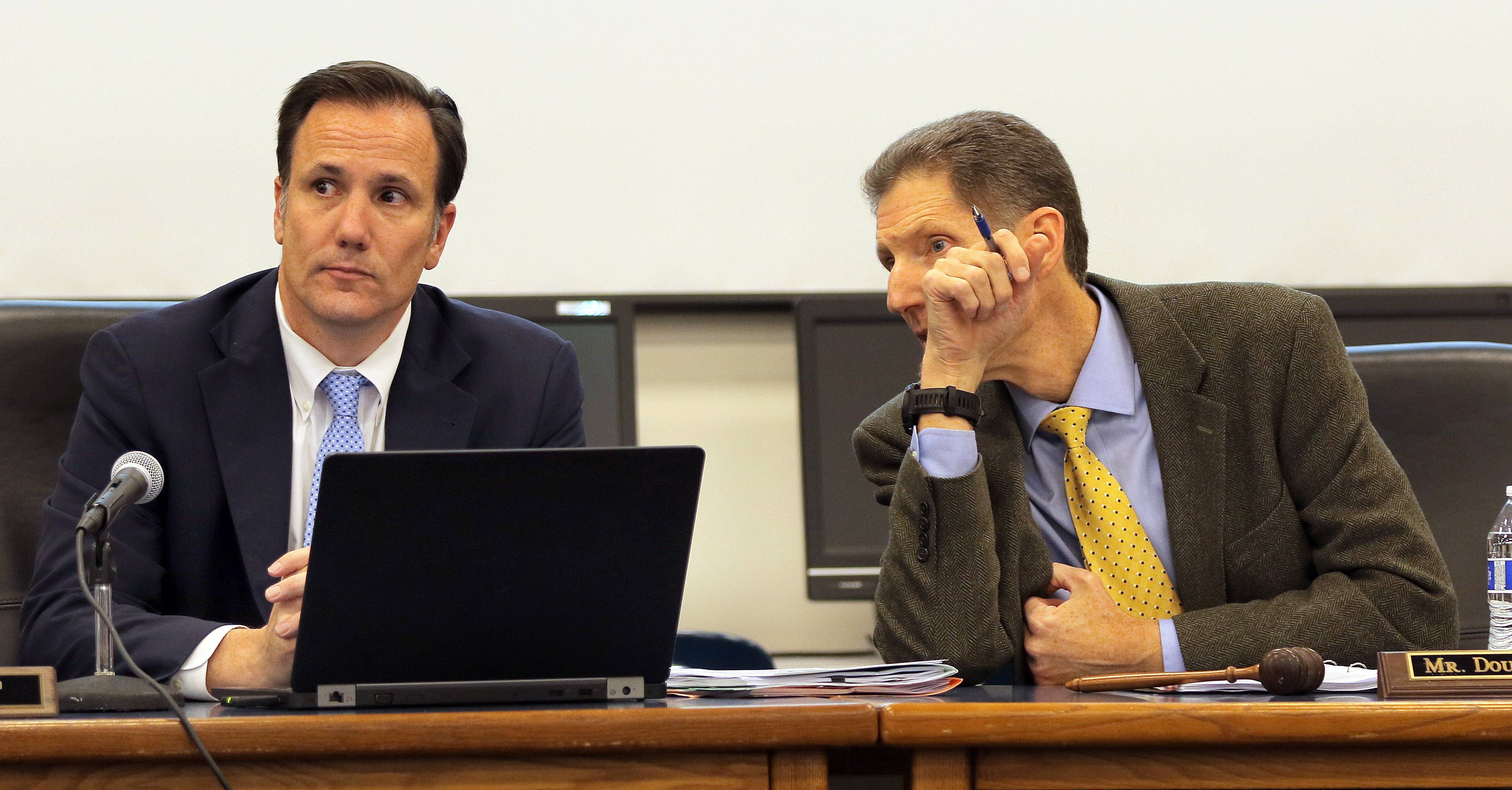 "Lake Zurich Unit District 95 Superintendent Kaine Osburn, left, and school board President Doug Goldberg talk during a Nov. 16 school board meeting when district officials said an internal investigation into ""inappropriate activity"" in a locker room involving the Lake Zurich High football team members is nearing completion."