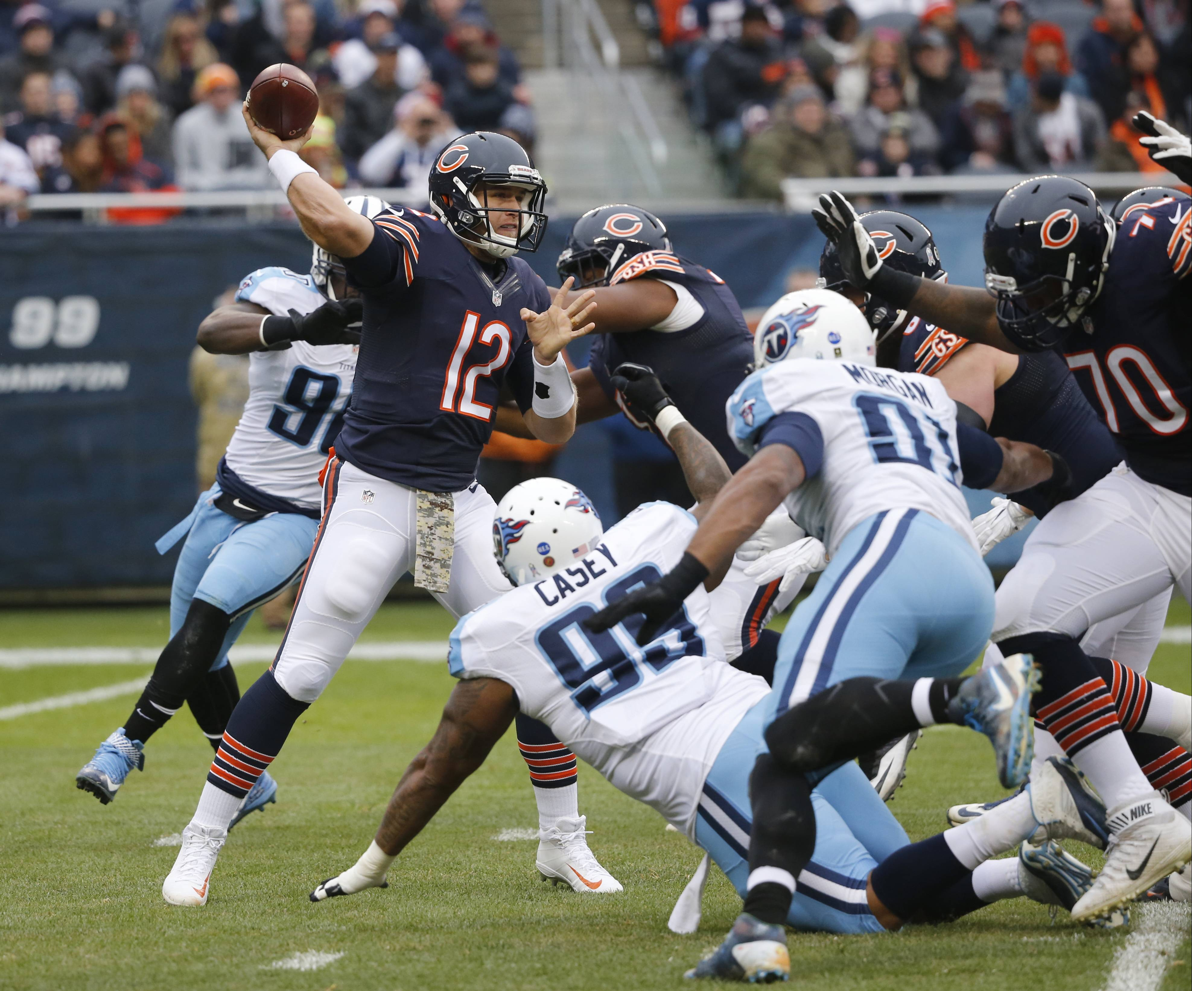 Chicago Bears quarterback Matt Barkley (12) throws a pass under pressure during the first half of an NFL football game against the Tennessee Titans, Sunday, Nov. 27, 2016, in Chicago.
