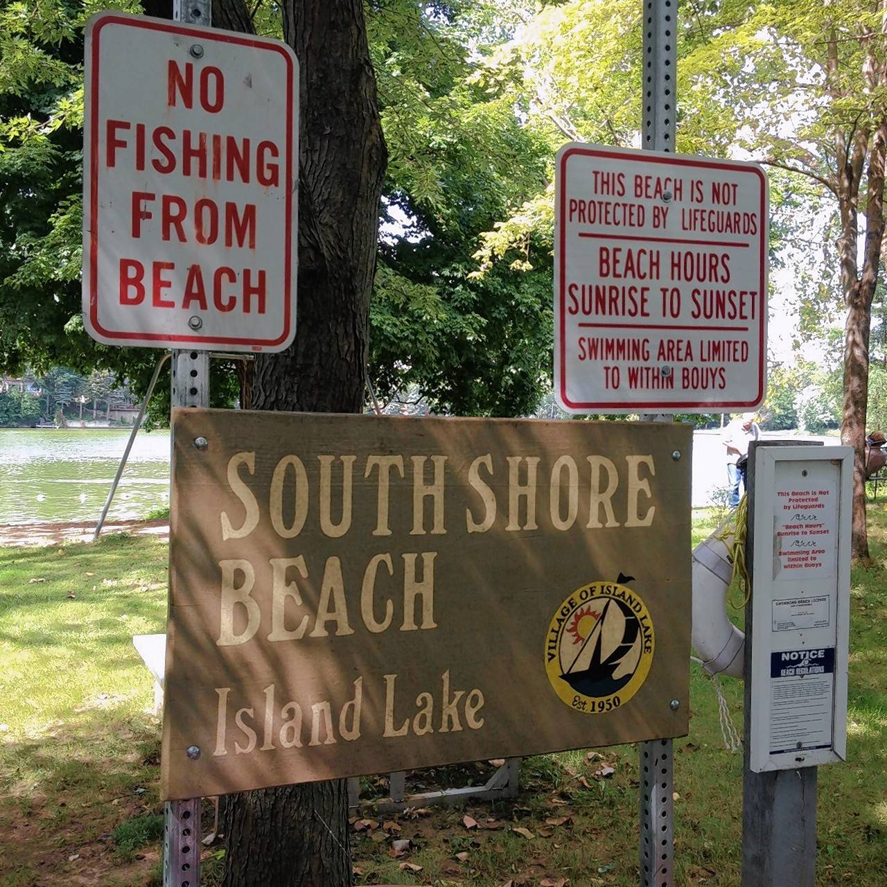 Plenty of guidance for patrons visiting one of the many public beaches in Island Lake.