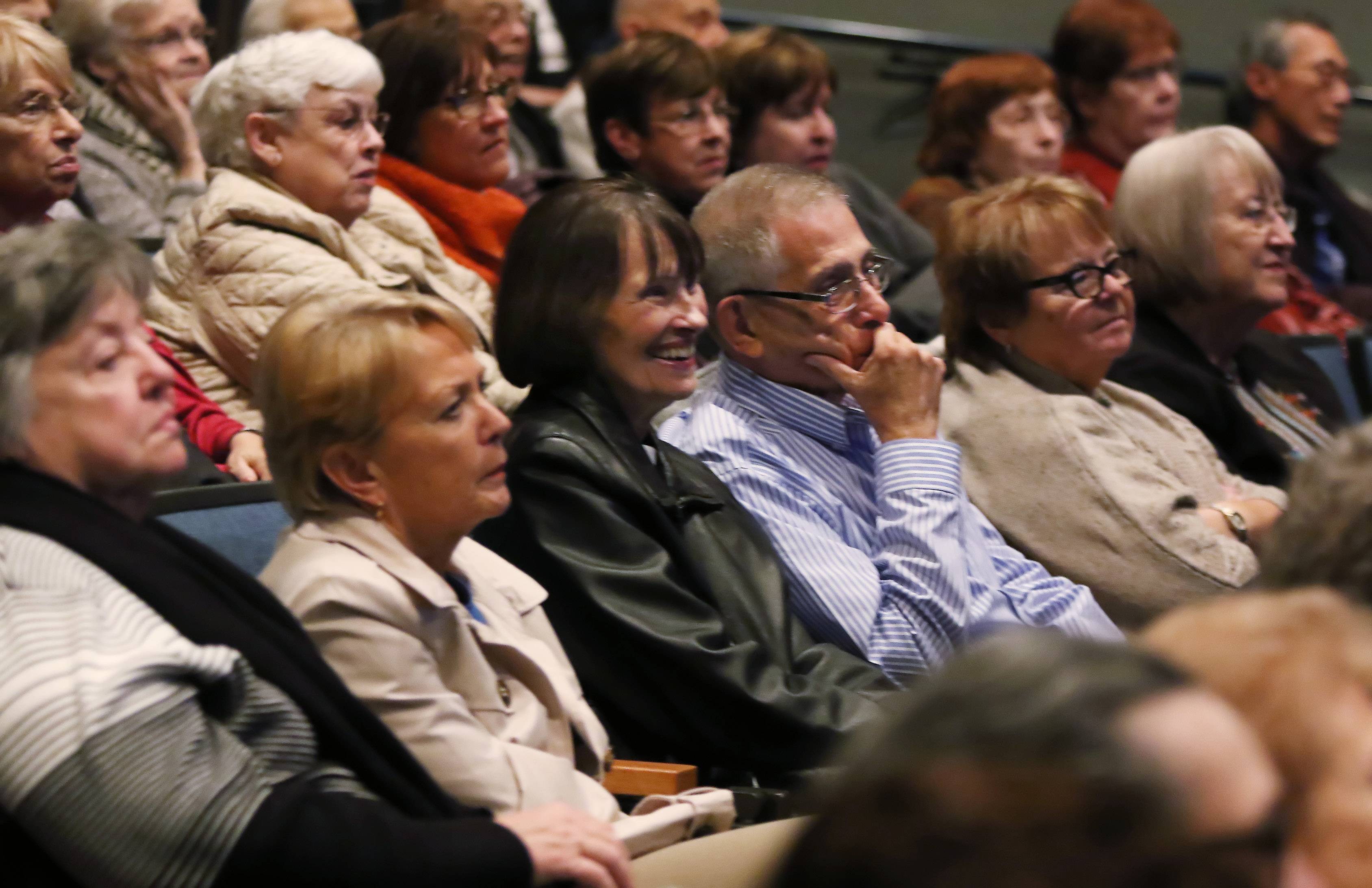 "The audience smiles as author Leslie Goddard discusses the history of Marshall Fields and Co. during ""Remembering Marshall Fields at Christmas"" at the Prairie Center for the Arts in Schaumburg."