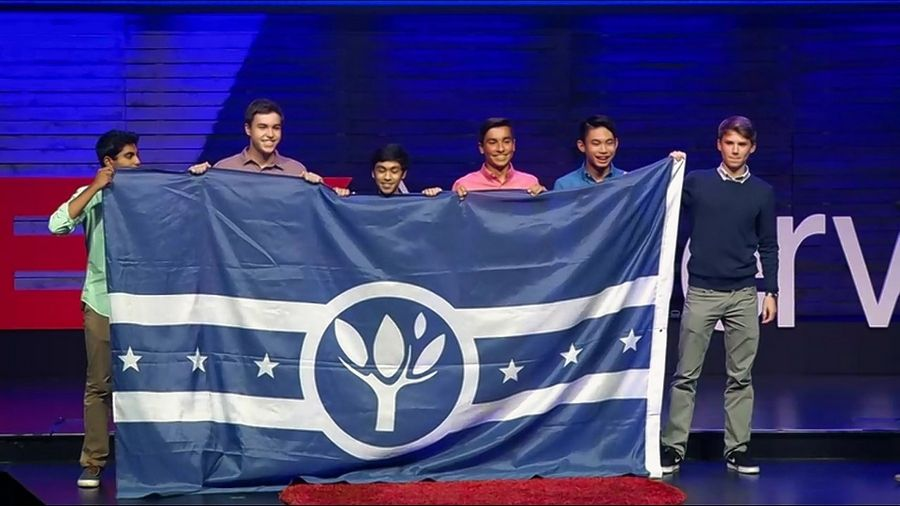 Neuqua Valley High School students Ritvik Manda, Jack Penrose, Haider Sarwar, Nathan Ashta, Andy Wang and Connor Tenny unveil a new flag for the city of Naperville designed and chosen through a campaign they ran. About 400 flags with the new design were distributed this month at the TEDx Naperville speakers conference.