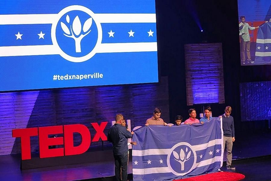 Six Neuqua Valley High School students who ran a campaign to design and choose a new flag to represent the city of Naperville say they now want to find a way to distribute the flag widely and have it adopted as the city's official municipal banner.