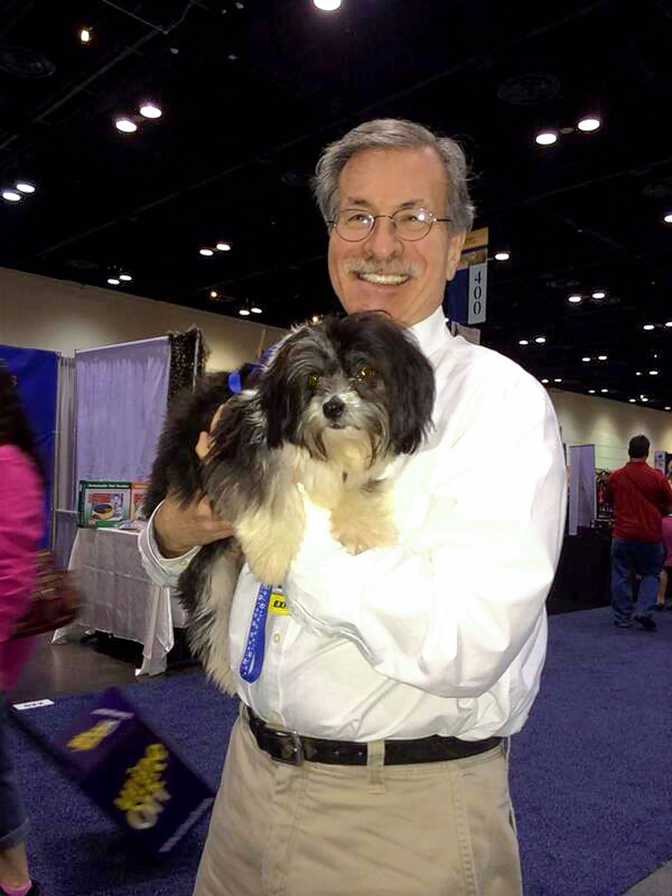 Dennis Abelson of Highland Park, holds a dog from a shelter in 2014. He is the co-founder of Matrix Partners Ltd. in Chicago.