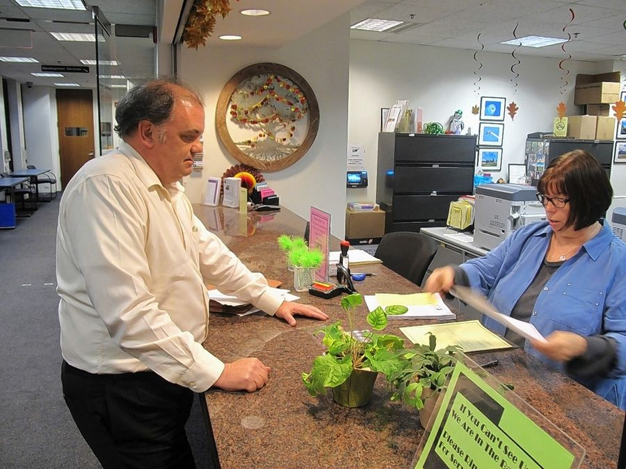Naperville City Council member Kevin Gallaher files his nominating petitions Monday afternoon to run for re-election to a seat on the council. Gallaher was the first of three candidates to arrive during the last hour of the filing period, entering him in a lottery for the last spot on the April 4 ballot.