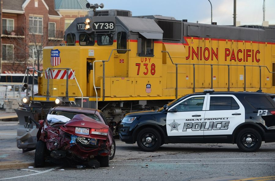 A freight train collided with a car Tuesday near the Metra station in downtown Mount Prospect.
