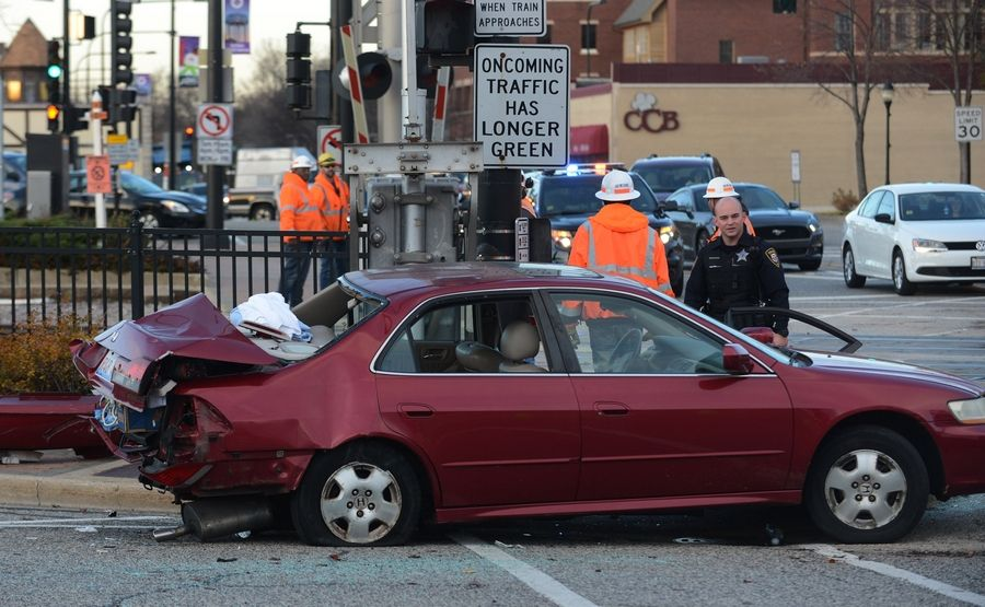 A Honda sedan rests on the south side of the Union Pacific Northwest Line tracks Tuesday afternoon at the intersection of Main Street and Prospect Avenue in Mount Prospect after a collision with a freight train.