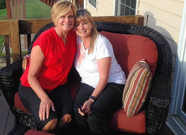 Lori Palmer, left, and her neighbor, Karen Sebestin, enjoy some time on Palmer's new deck furniture.