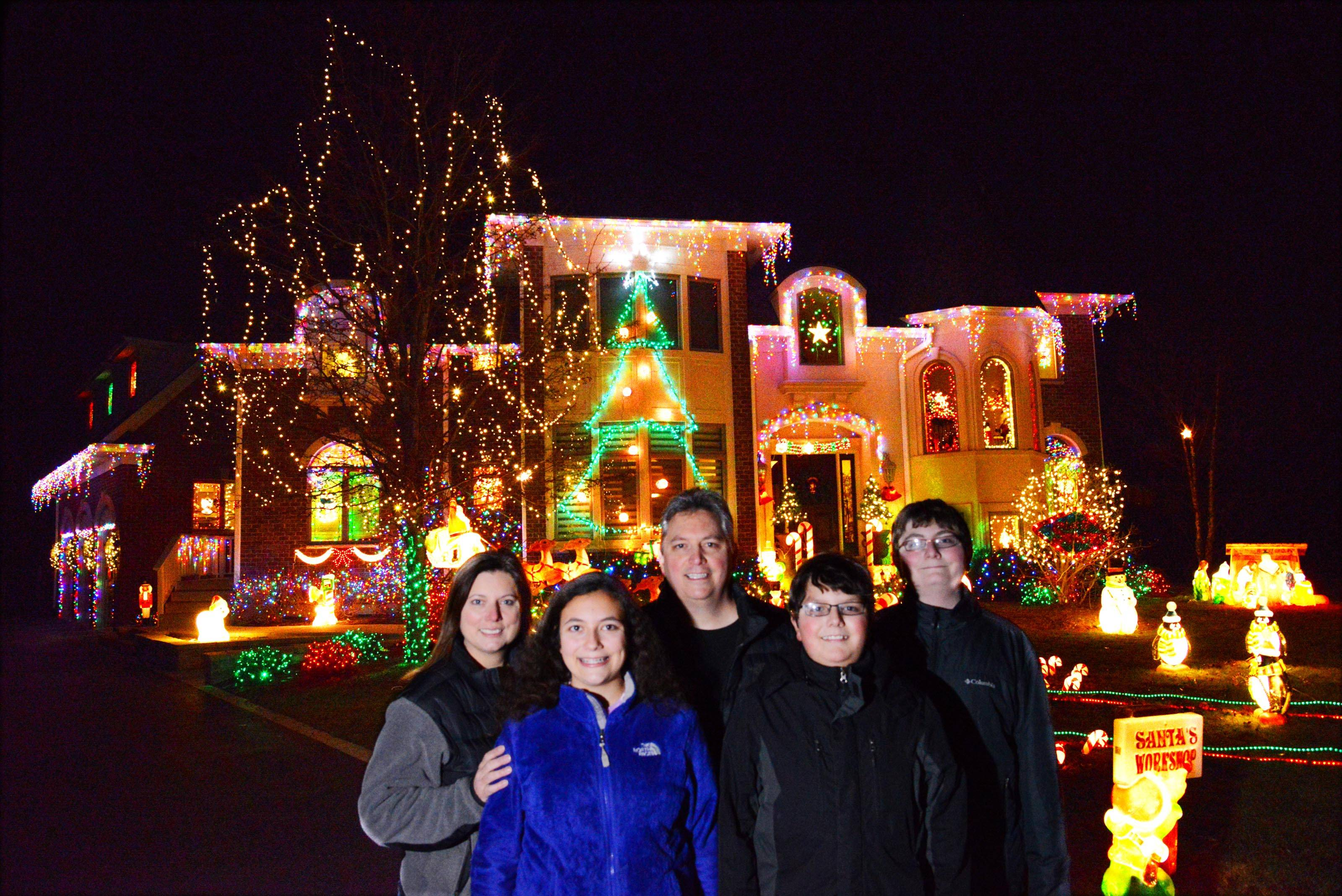Dante Fiandaca, the 2015 contest winner, had about 19,000 lights on his home at 6 Grayhawk Court in Algonquin. He's shown here with his wife, Sherry, daughter, Jackie, 13, who designed the light layout, and sons Johnny, 12, and Dante Jr., 14.