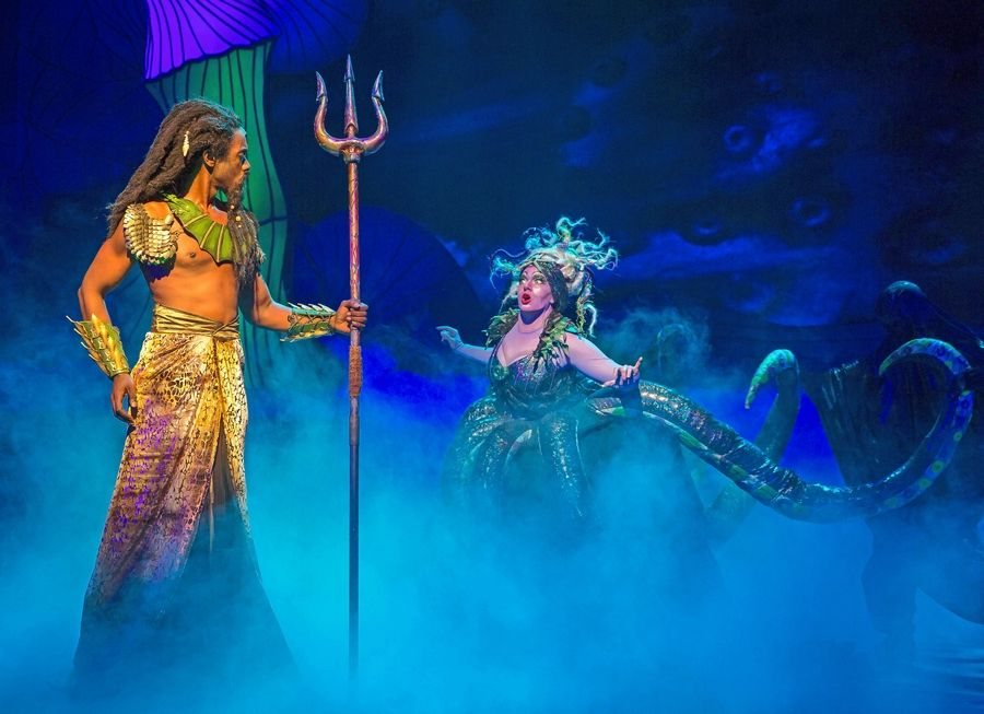 "King Triton (Evan Tyrone Martin) confronts the sea witch Ursula (Christina Hall) in Paramount Theatre's production of ""The Little Mermaid."""
