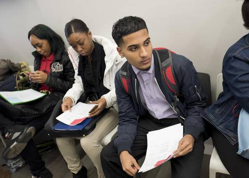 In this Tuesday, Nov. 15, 2016, photo, Ammer Gondal, who is looking for work in the retail or food industry, waits to see a recruiter during a job fair hosted by the Gregory Jackson Center for Brownsville, in the Brooklyn borough of New York. U.S. companies added a solid 216,000 jobs in November, the most since June and evidence that the incoming Trump administration is inheriting a solid economy. Payroll provider ADP said Wednesday, Nov. 30, nearly all the gains occurred in service sectors such as retail, hotels and restaurants, as well as higher-paying professional services. Construction firms added 2,000 jobs, while manufacturing shed 10,000.