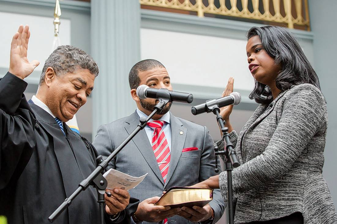 Chief Cook County Judge Timothy Evans swears in Kim Foxx as Cook County's first black female state's attorney Thursday.