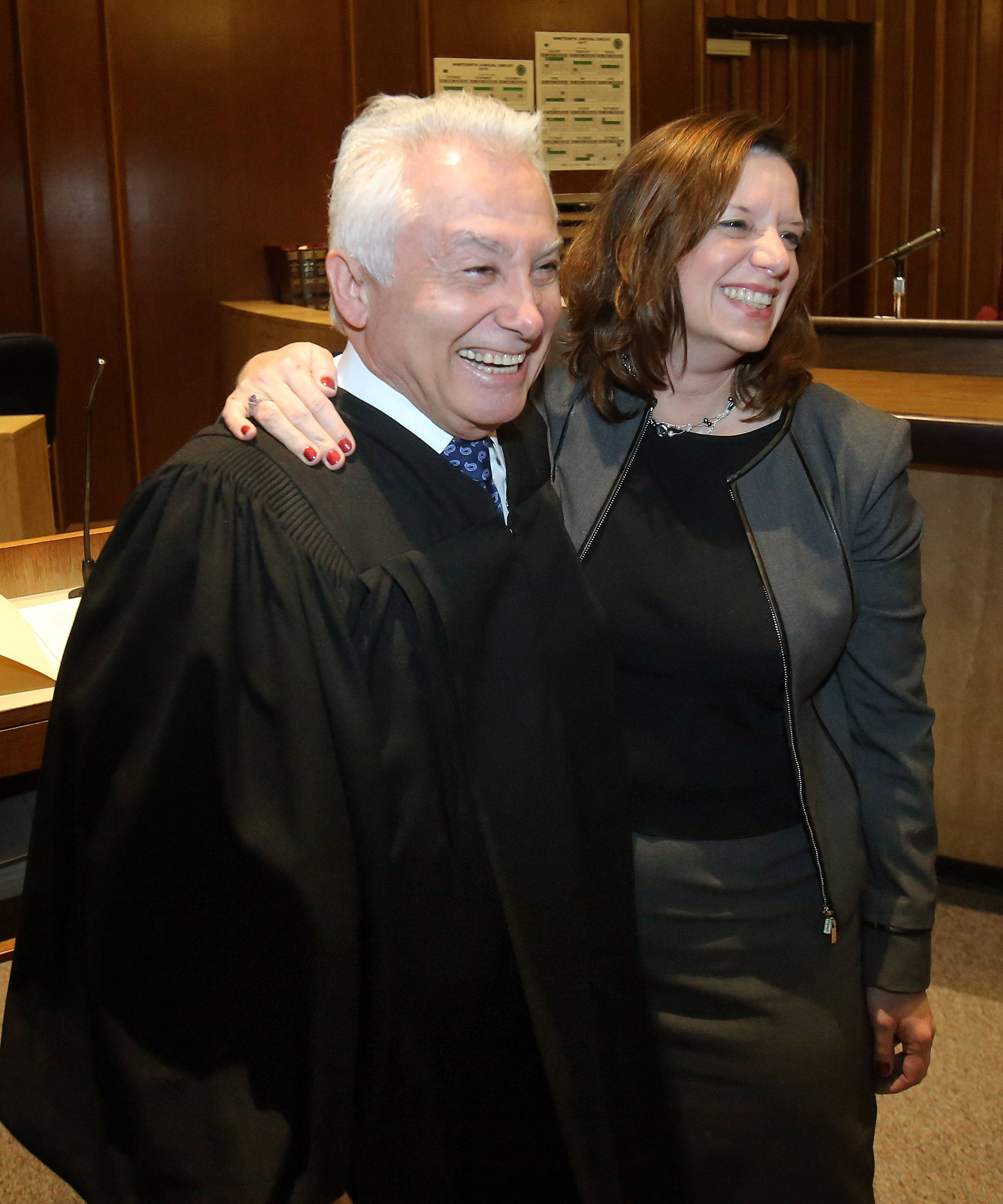 Erin Cartwright Weinstein, right, and Circuit Judge Jame Booras embrace after she was sworn in as Lake County circuit court clerk Thursday in Waukegan.