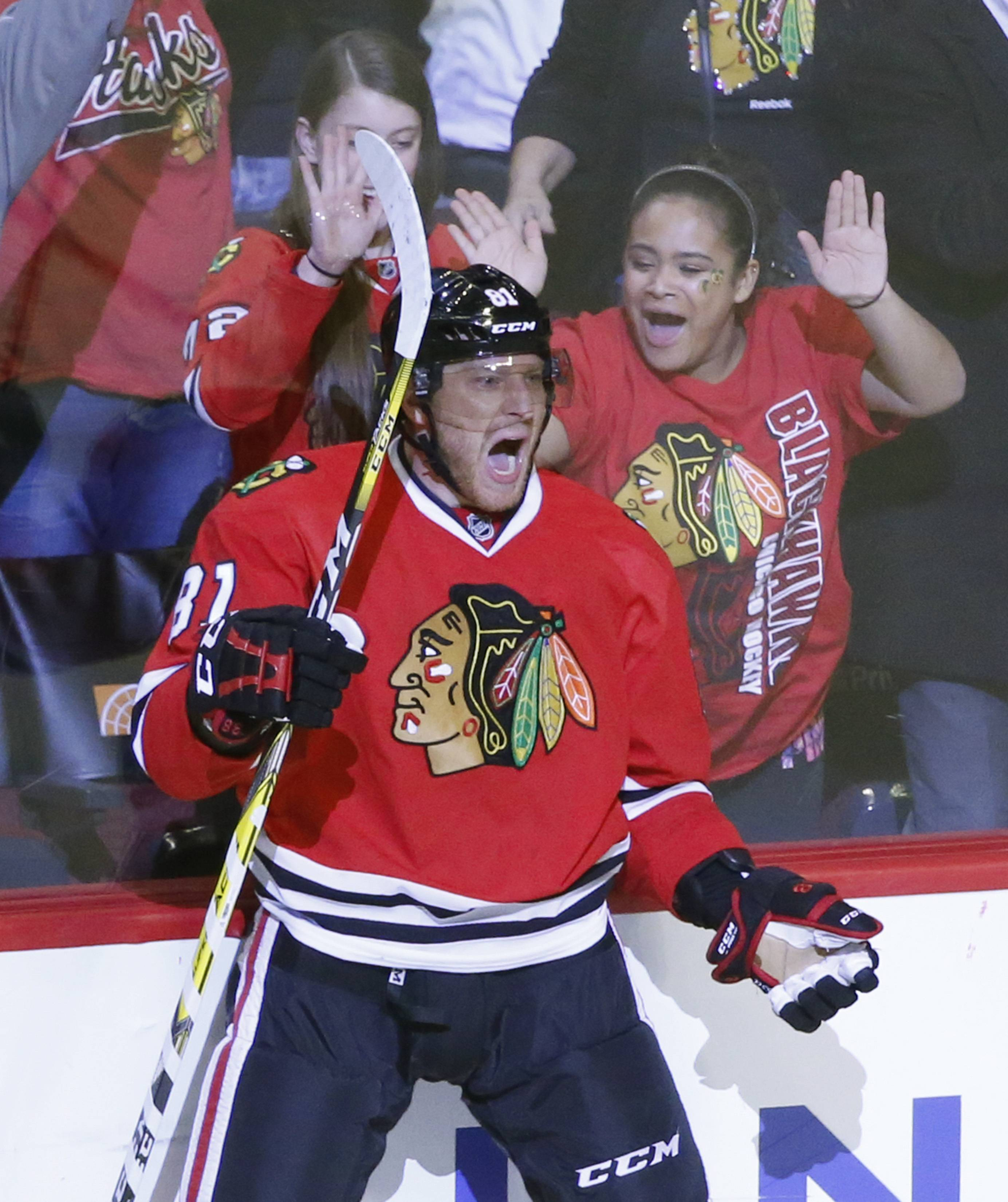 Chicago Blackhawks' Marian Hossa (81) celebrate his game winning goal during the overtime period of an NHL hockey game against the New Jersey Devils Thursday, Dec. 1, 2016, in Chicago. The Blackhawks won 4-3.
