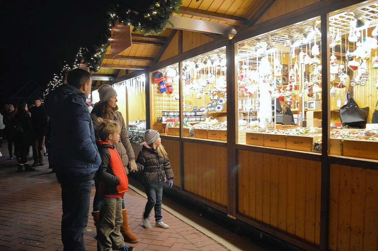 Families and shoppers stopped by in crowds beginning on Black Friday for the opening weekend of Christkindlmarket Naperville at the Naper Settlement. The market runs Thursdays through Sundays until Christmas Eve.