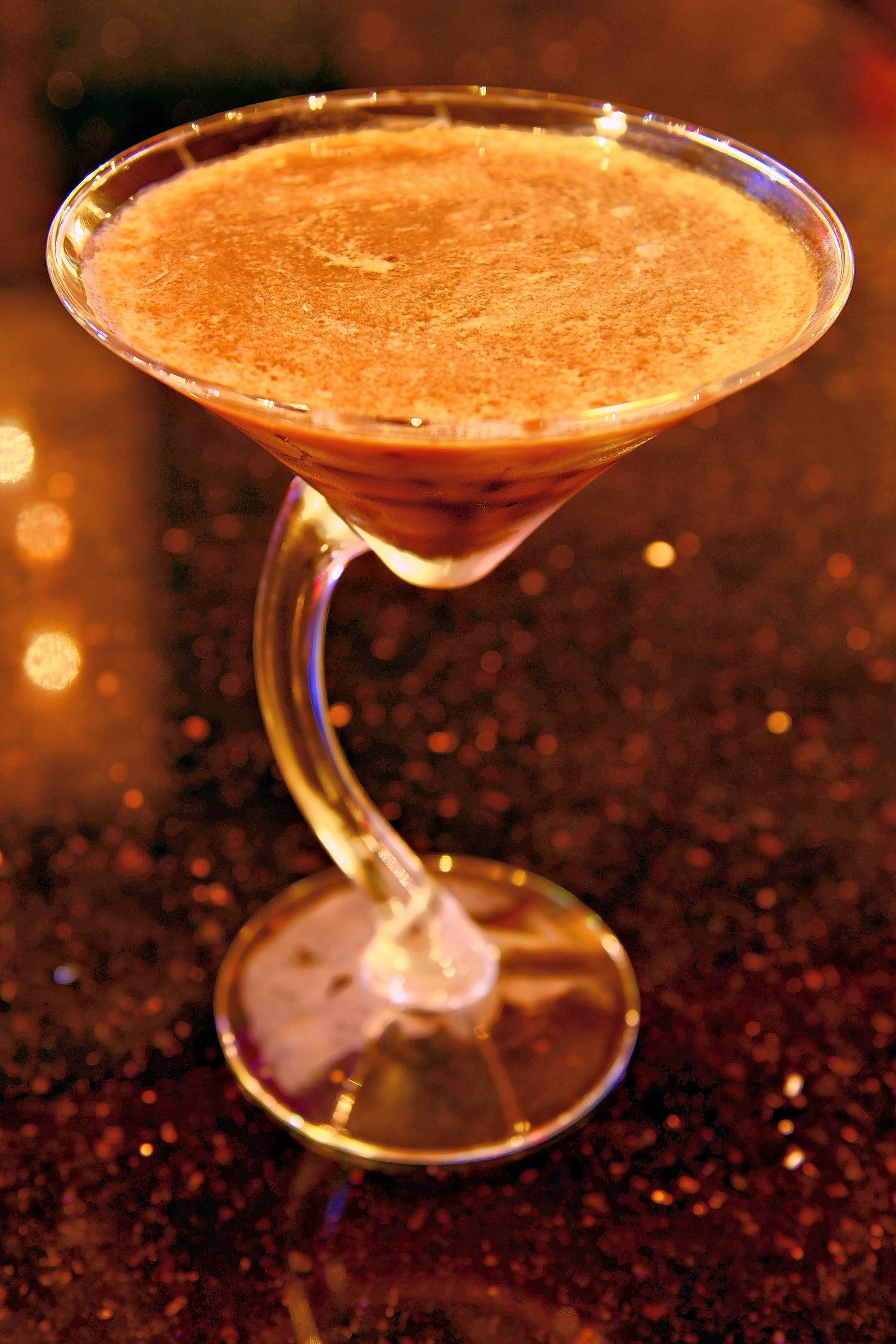The Martini Room's espresso martini blends Bailey's, Kahlua and Van Gogh double espresso vodka with chocolate-covered roasted coffee beans at the bottom of the glass and espresso powder on top.