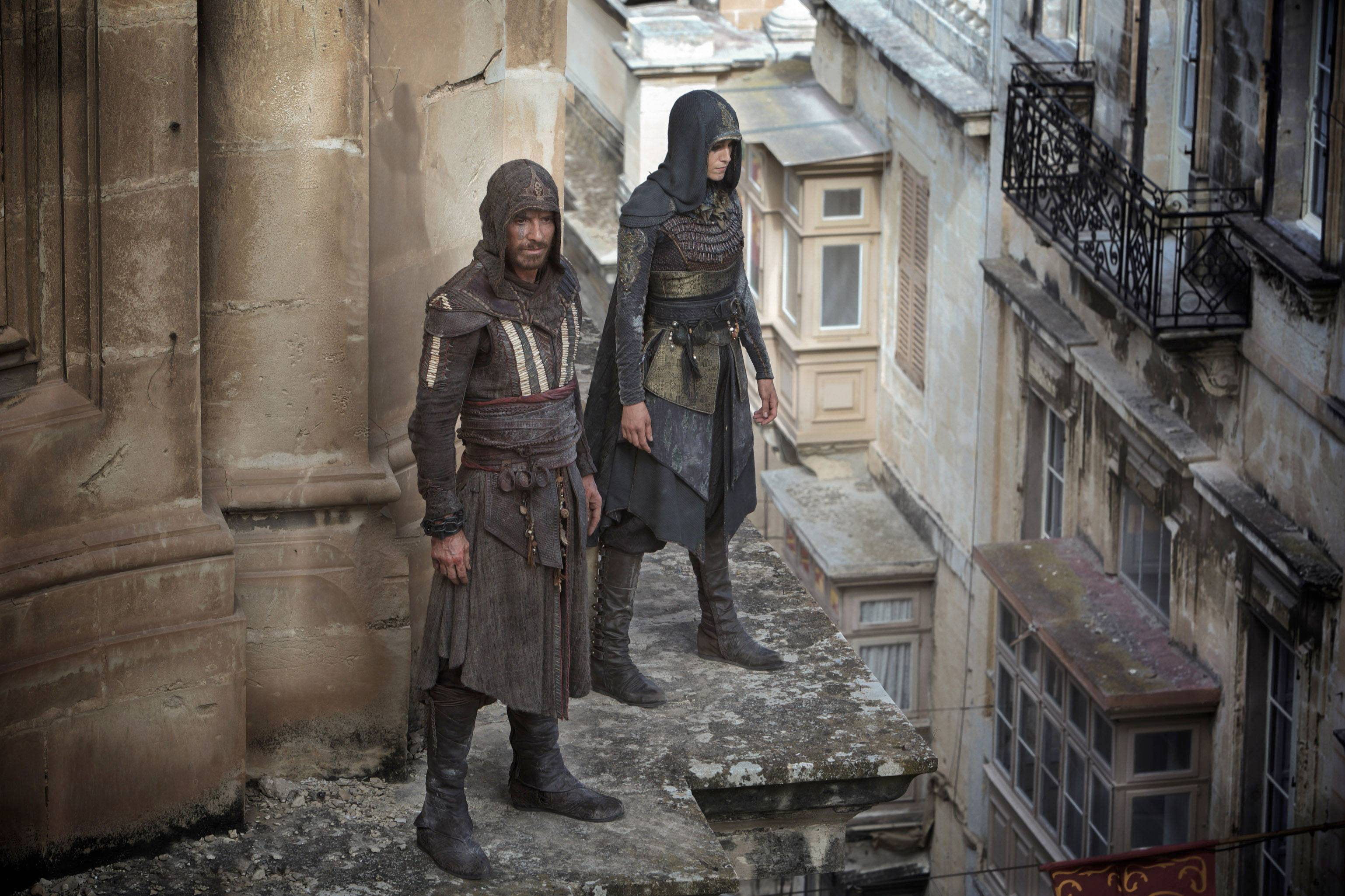 "Michael Fassbender, left, and Ariane Labed star in ""Assassin's Creed,"" coming to theaters Dec. 21."