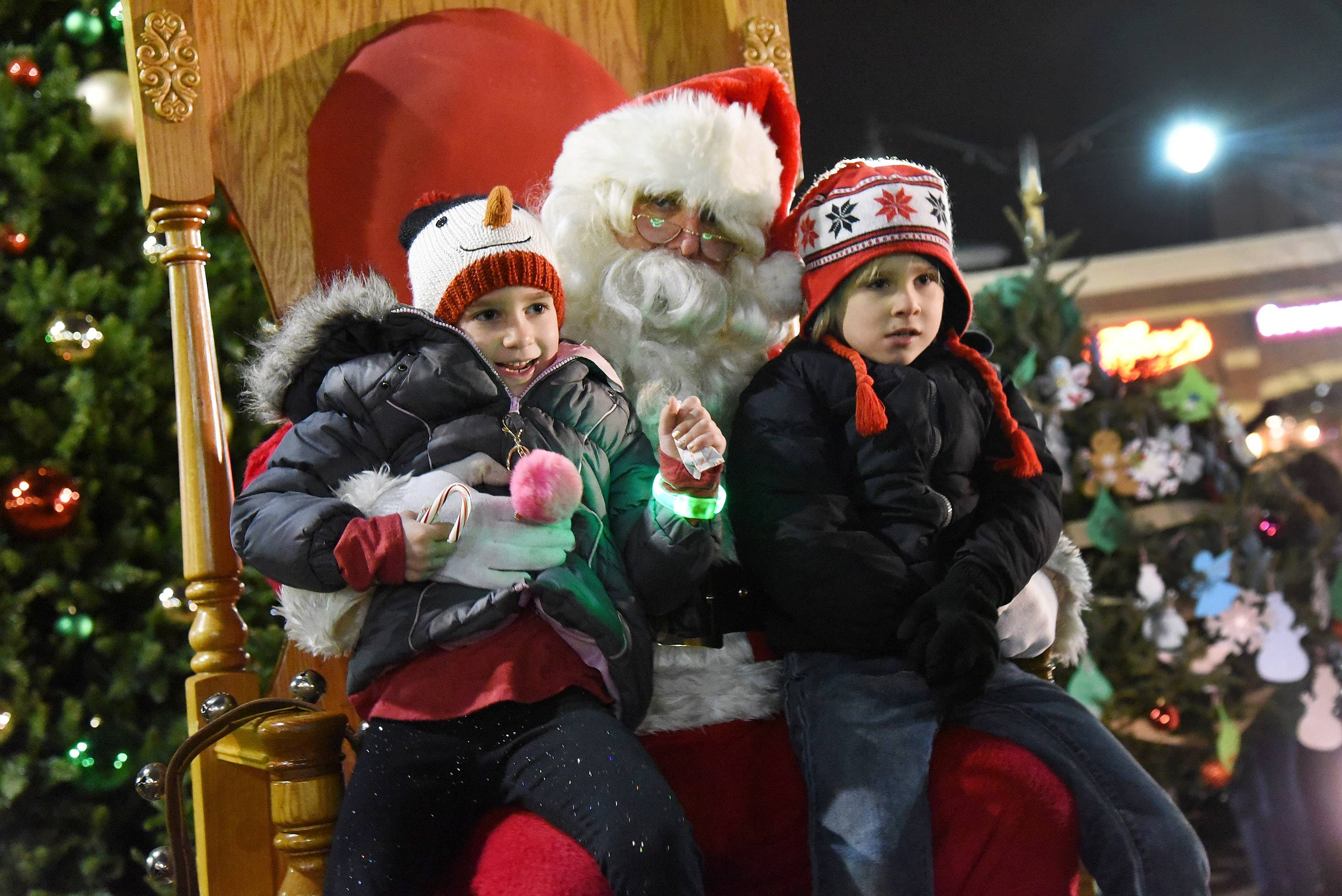 Kinzie and Jake Morgan of Des Plaines visit with Santa during the Des Plaines holiday lighting festivities in Metropolitan Square.