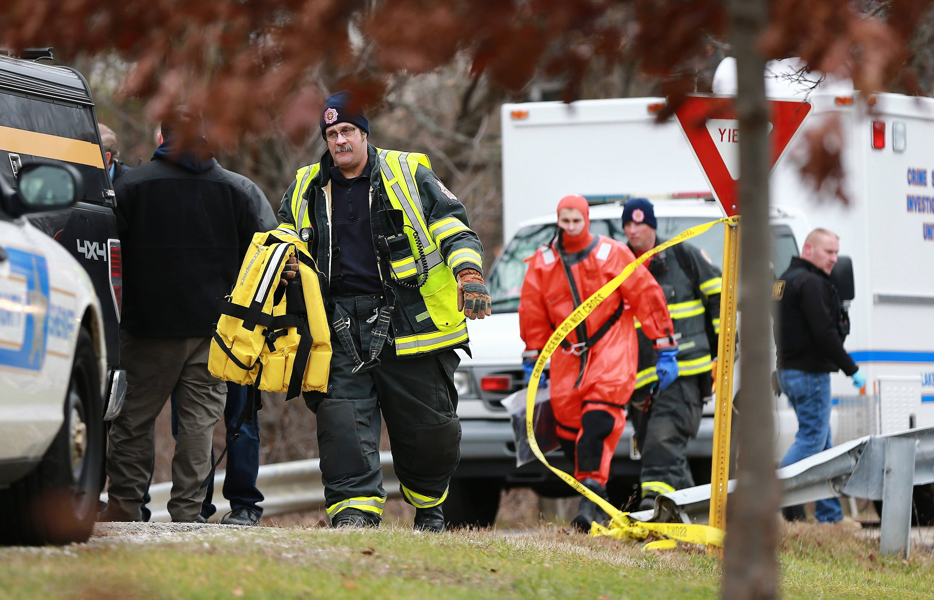 Crews from the Countryside Fire Protection District and Lake County Sheriff's police at Sylvan Lake near Mundelein, where a woman's body was discovered Friday.