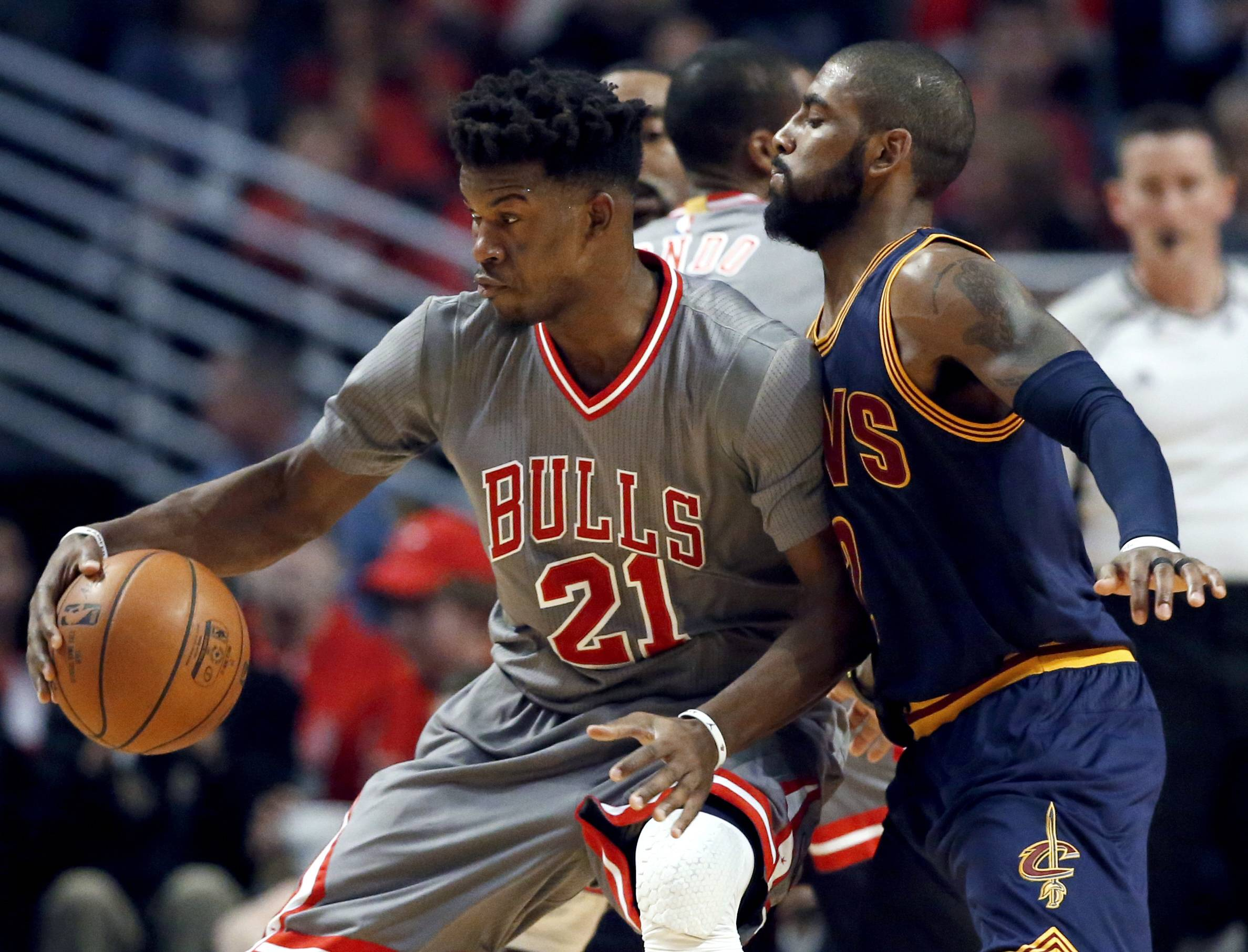 Chicago Bulls guard guard Jimmy Butler, left, works against Cleveland Cavaliers guard Kyrie Irving during the first half of an NBA basketball game Friday, Dec. 2, 2016, in Chicago. (AP Photo/Nam Y. Huh)