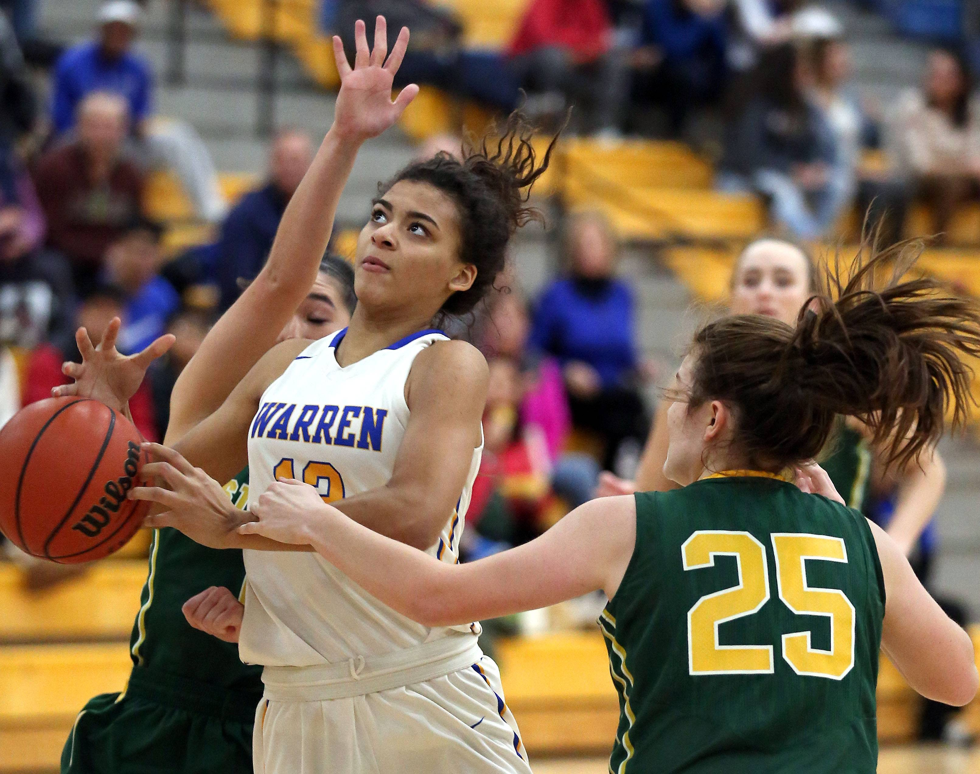 Warren's Kaylen Dickson, left, drives on Stevenson's Ashley Richardson.