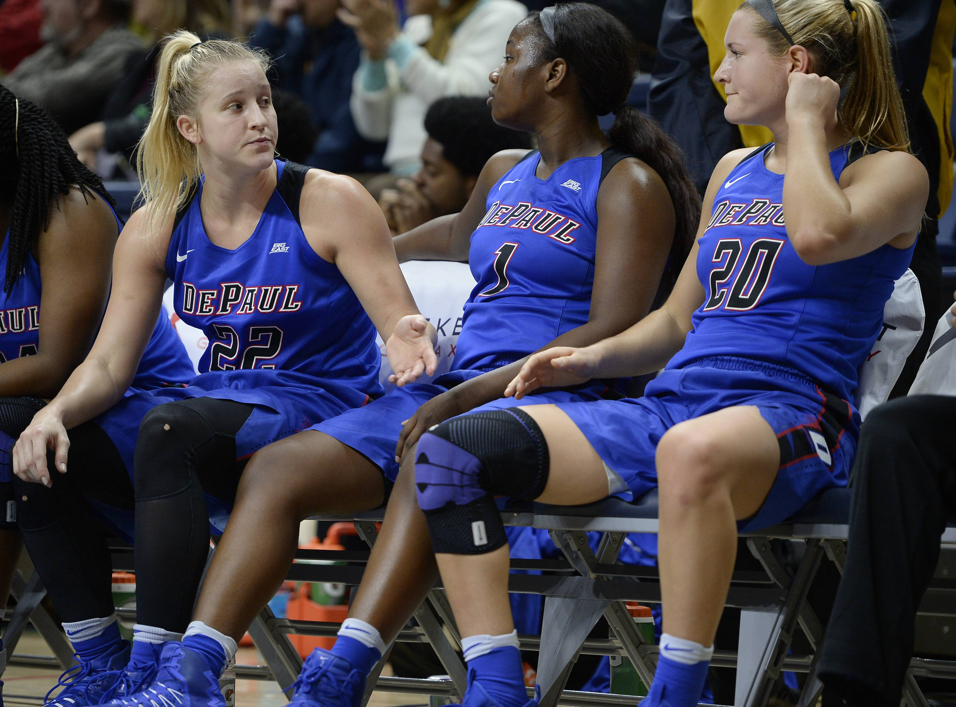 DePaul's Brooke Schulte, left, Ashton Millender, center, and Kelly Campbell sit on the bench in the final seconds of Thursday's 91-46 loss to the powerhouse UConn Huskies.