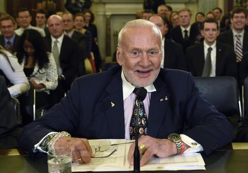 FILE - In this Tuesday, Feb. 24, 2015, file photo, Buzz Aldrin, former NASA Astronaut and Apollo 11 Pilot, prepares to testify on Capitol Hill in Washington, before the Senate subcommittee on Space, Science, and Competitiveness hearing on human exploration goals and commercial space competitiveness. Officials said Aldrin, one of the first men to walk on the moon, has been evacuated by plane from the South Pole for medical reasons. An association of Antarctica tour operators said Thursday, Dec. 1, 2016, that Aldrin was visiting the South Pole as part of a private tourist group when his health deteriorated.