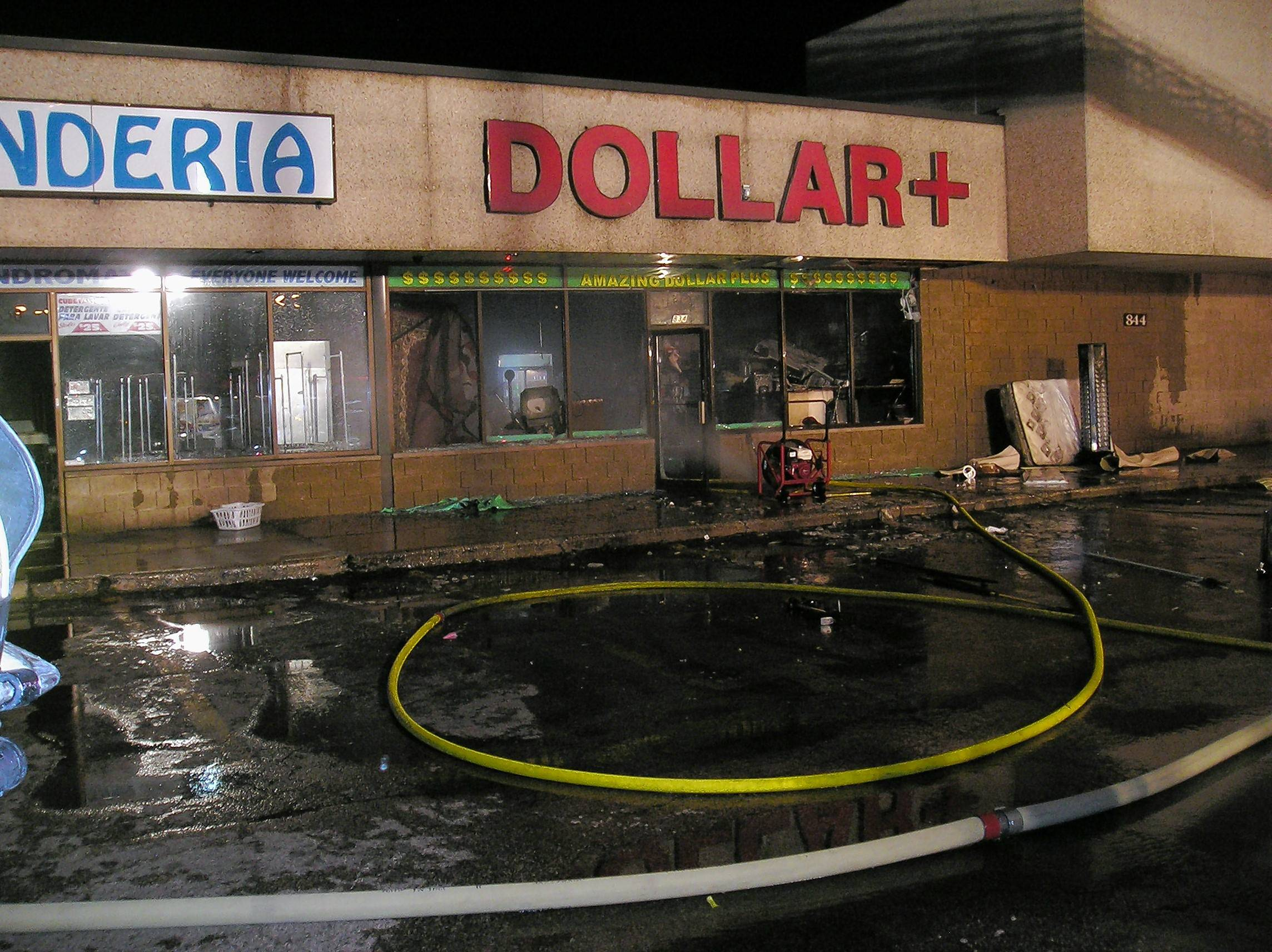 The Dollar+ store in the 800 block of Summit Street was badly damaged in a fire late Friday. Neighboring businesses also were damaged and remain closed today.