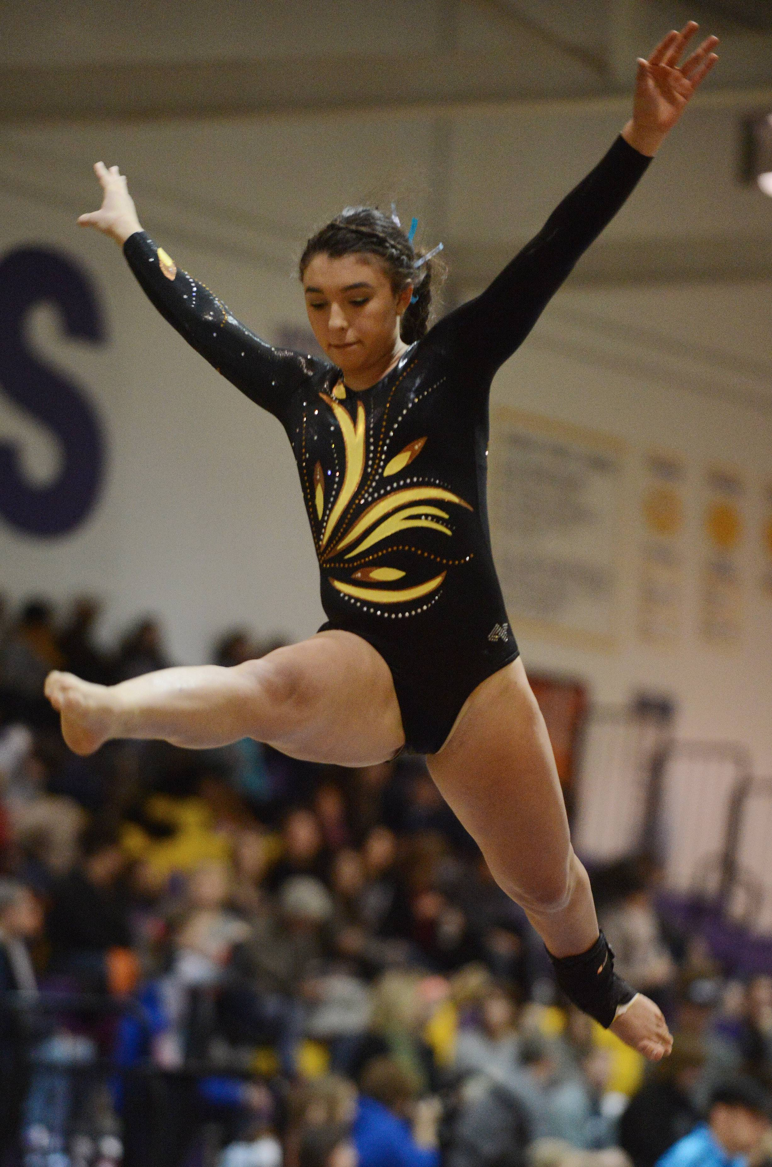 Carmel's Samantha Wahlers competes on the balance beam during the Rolling Meadows invitational Saturday.