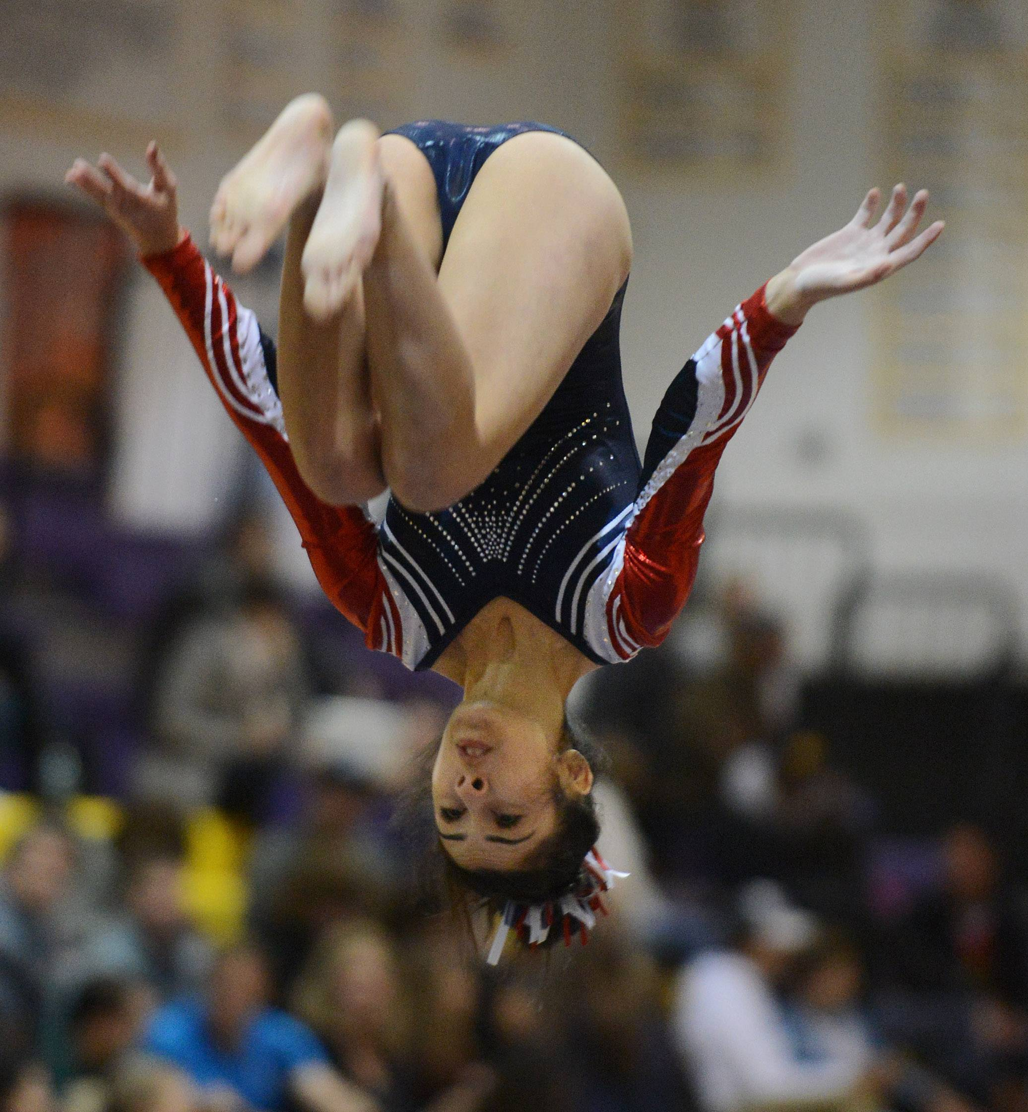 Conant's Mariana Vazquez-Rosas competes on the balance beam during the Rolling Meadows invitational Saturday.